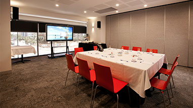 Tolmer meeting room configuration with projector for Oaks Elan Darwin