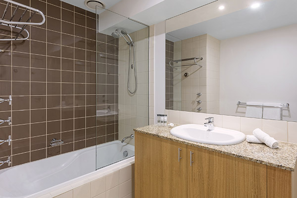 melbourne cbd hotels en suite bathroom of 2 Bedroom Apartment with toilet, shower and mirror at Oaks on Market hotel in Melbourne city, Victoria, Australia